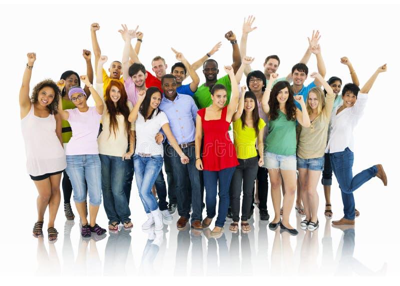 Groupe divers de célébration des jeunes photographie stock