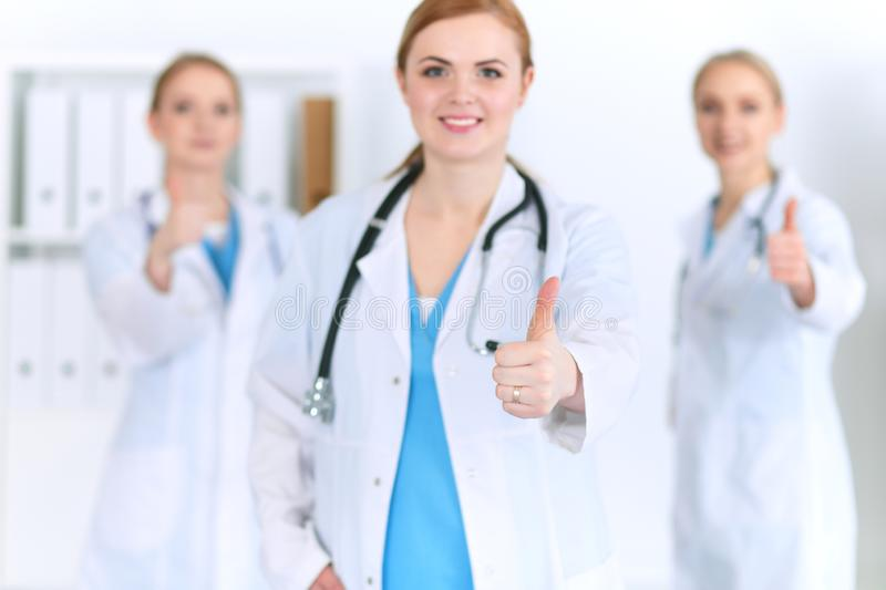 Groupe of medicine doctors show OK sign with thumb up. Success and high level service in health care, best treatment and. Customer loyalty and physical concept royalty free stock photo