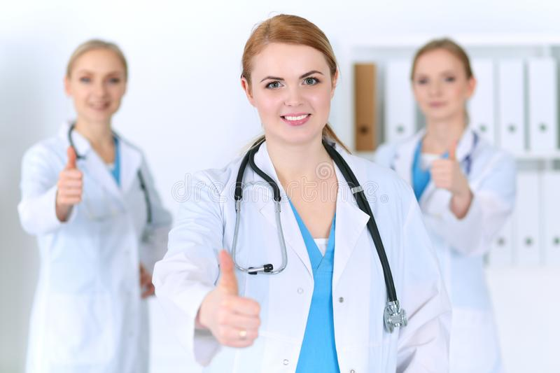 Groupe of medicine doctors show OK sign with thumb up. Success and high level service in health care, best treatment and. Customer loyalty and physical concept royalty free stock photos