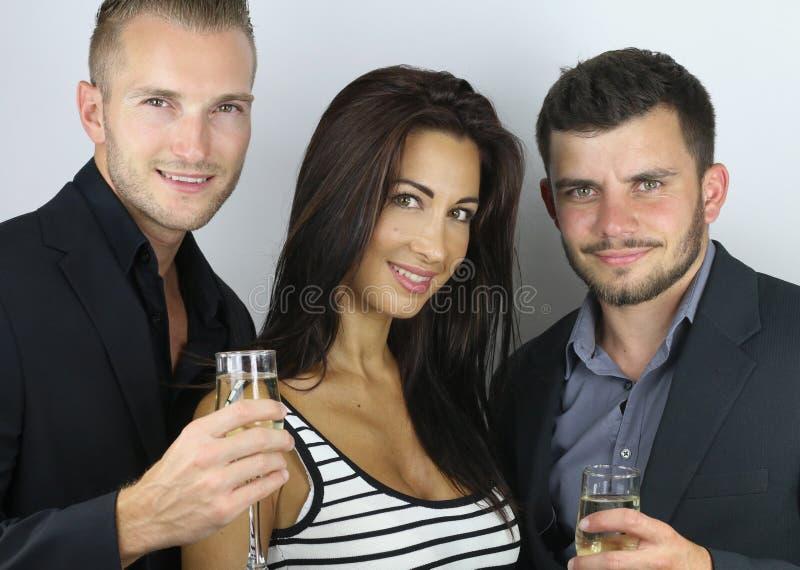 Groupe van mensen viert het nieuwe jaar stock foto's