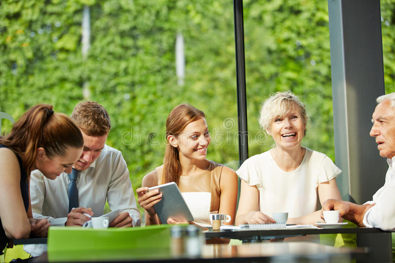 Groupf of business people working in canteen royalty free stock images