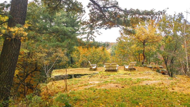 Arodinak Chairs on a Scenic Overlook in Wisconsin. A grouping of arodinak chairs on a scenic overlook in the driftless region of Wisconsin royalty free stock photo