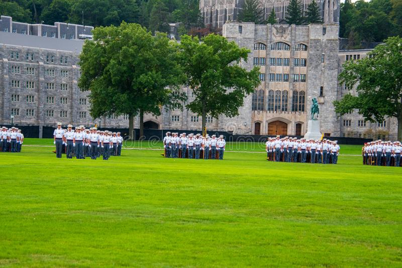 Groups of Army cadets in formation holding rifles on the West Point Military Academy parade field royalty free stock photo