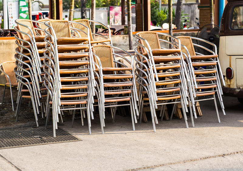 Groups of chairs stacked and chained together outdoors royalty free stock photo