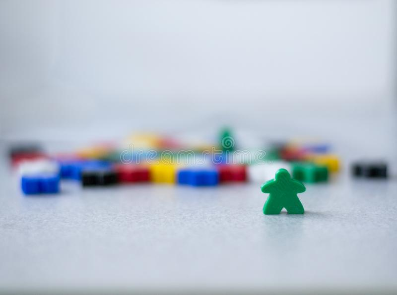 Groups of colorful meeples of two teams. Colors of ukrainian flag - blue and yellow. Small figures of man stock photography