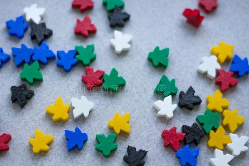 Groups of colorful meeples of two teams. Colors of ukrainian flag - blue and yellow. Small figures of man stock photos
