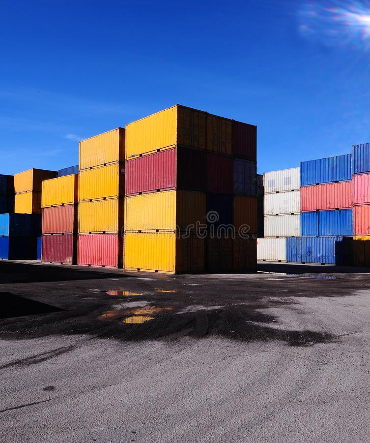 Hundreds of containers stacked on piles stock photos