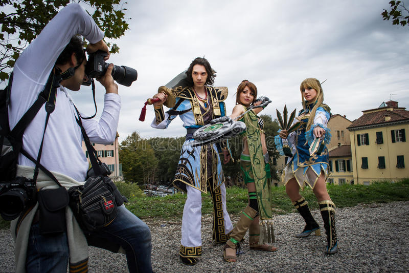 Groups of costumed players are photographed