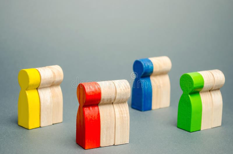 Groups of multicolored wooden people. The concept of market segmentation. Target audience, customer care. Market group of buyers. stock photo