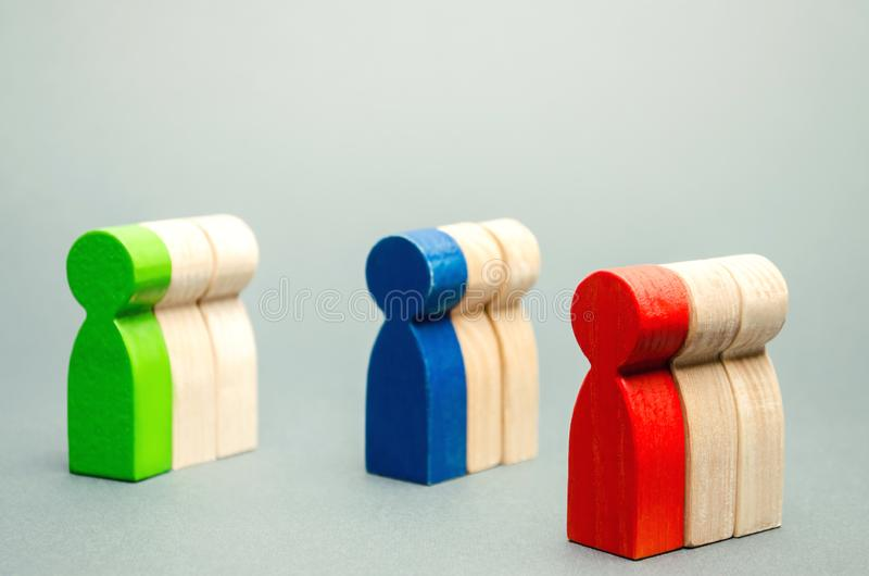 Groups of multicolored wooden people. The concept of market segmentation. Target audience, customer care. Market group of buyers. royalty free stock photography