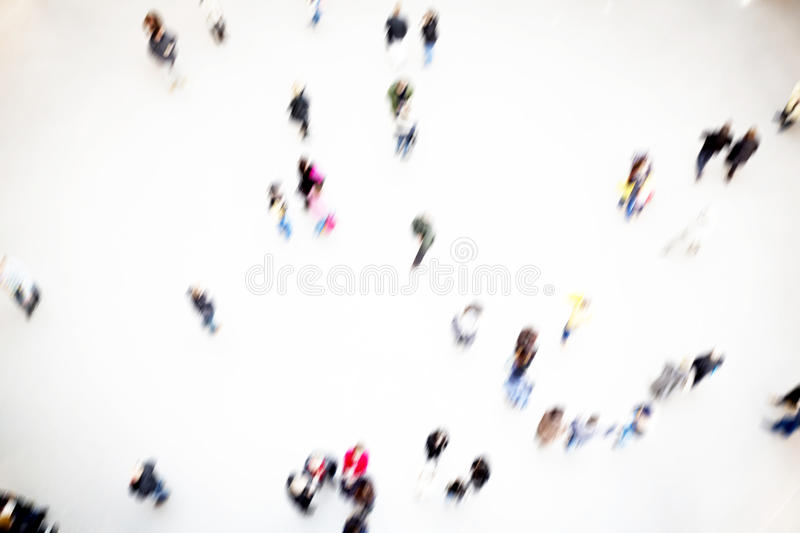 Groups of people moving, blurry. Groups of people moving inside a hall, blurry royalty free stock images