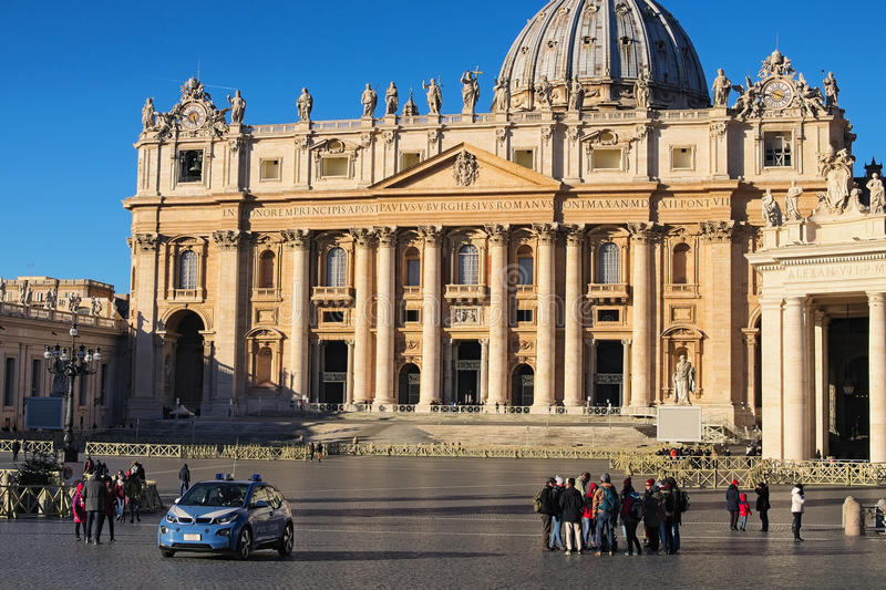 Groups of tourists gather in St. Peter`s Square in Rome for excursions to the Vatican and St. Peter`s Cathedral. royalty free stock photo