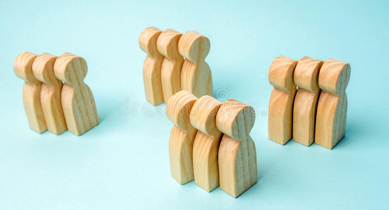 Groups of wooden people. The concept of market segmentation. Marketing segmentation, target audience, customer care. Market group stock photo