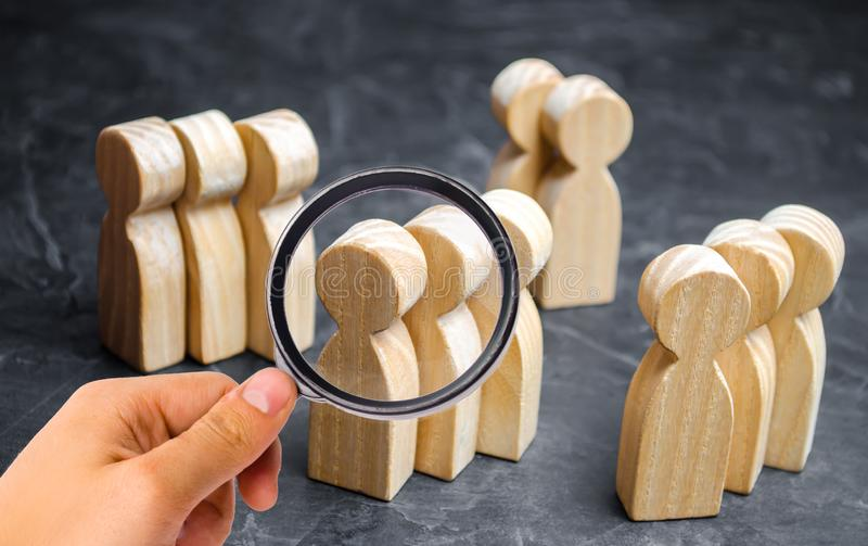 Groups of wooden people. The concept of market segmentation. Marketing segmentation, target audience, customer care. Market group royalty free stock images