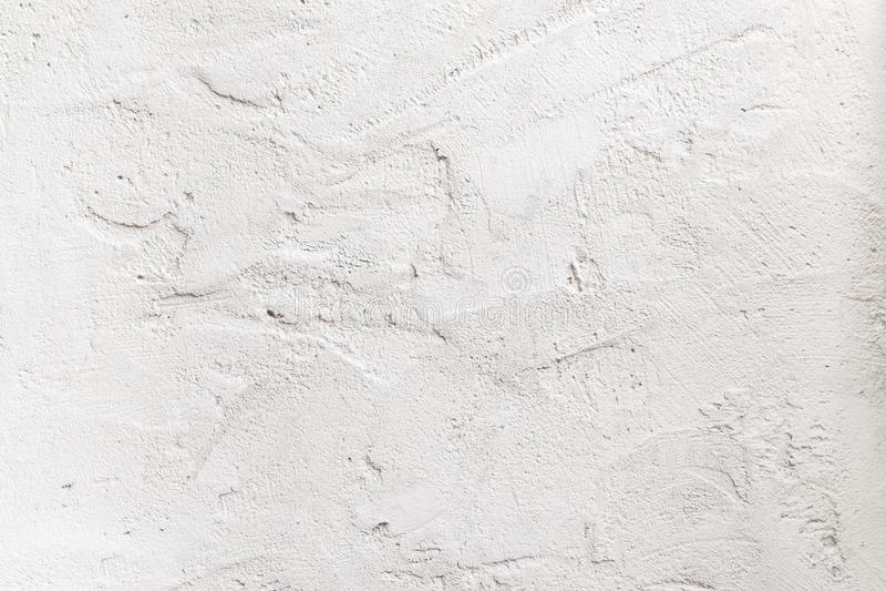 Grov betongvägg för Grunge med skrapat, texturbakgrund royaltyfri bild