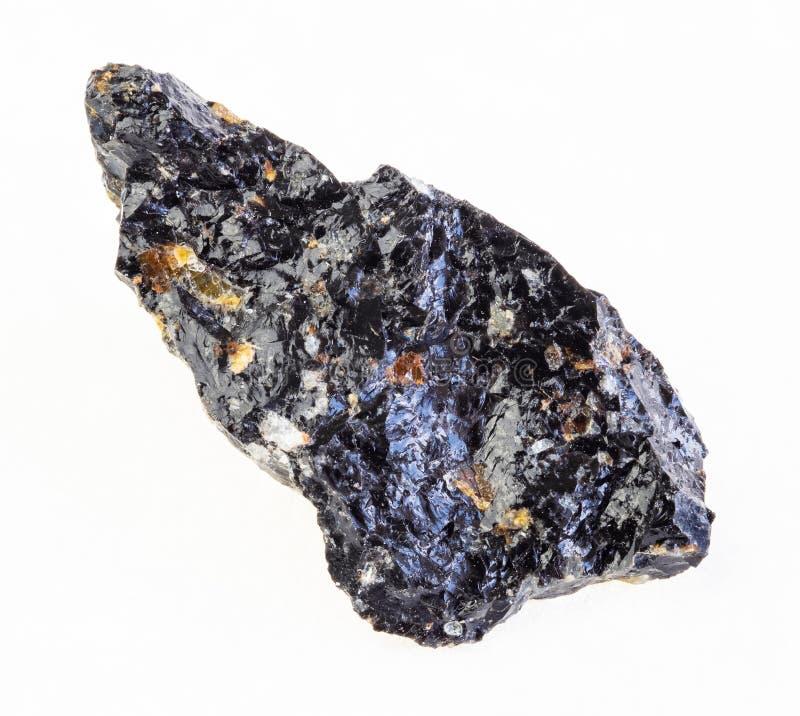 grov sten för obsidian (vulkaniskt exponeringsglas) på vit arkivfoto