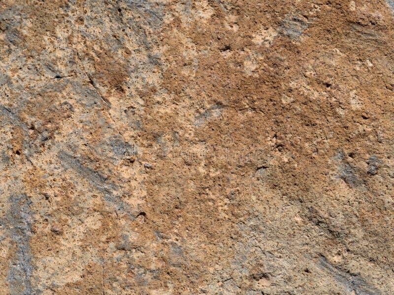 Grov stenvägg i bruna signaler fotografering för bildbyråer