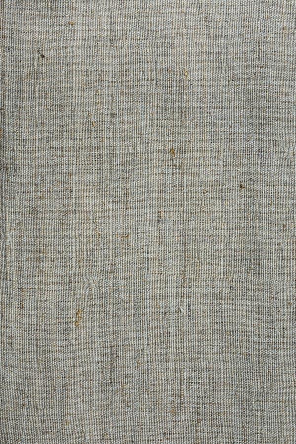 Grov textur för tyg för linnekanfas, bakgrund som vävas, tapet, ljus - grå färger och beigasignaler arkivbilder