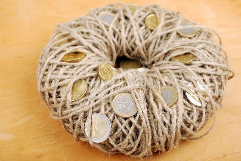 Grova trådar och mynt för Plexus royaltyfri bild