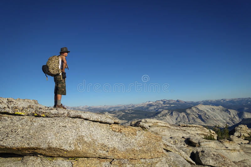 Groveland, California - United States - July 24, 2014: Man hikes to top of Mt. Hoffman, a peak near Olmsted Point, in Yosemite. This granite overlook can be stock photos