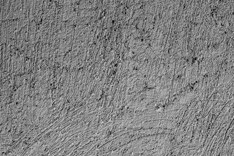Grovt kornigt texturerat grå cementbakgrund på cementbyggets fasad royaltyfria foton