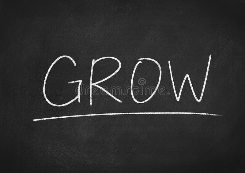 Grow. Concept word on blackboard background stock photo