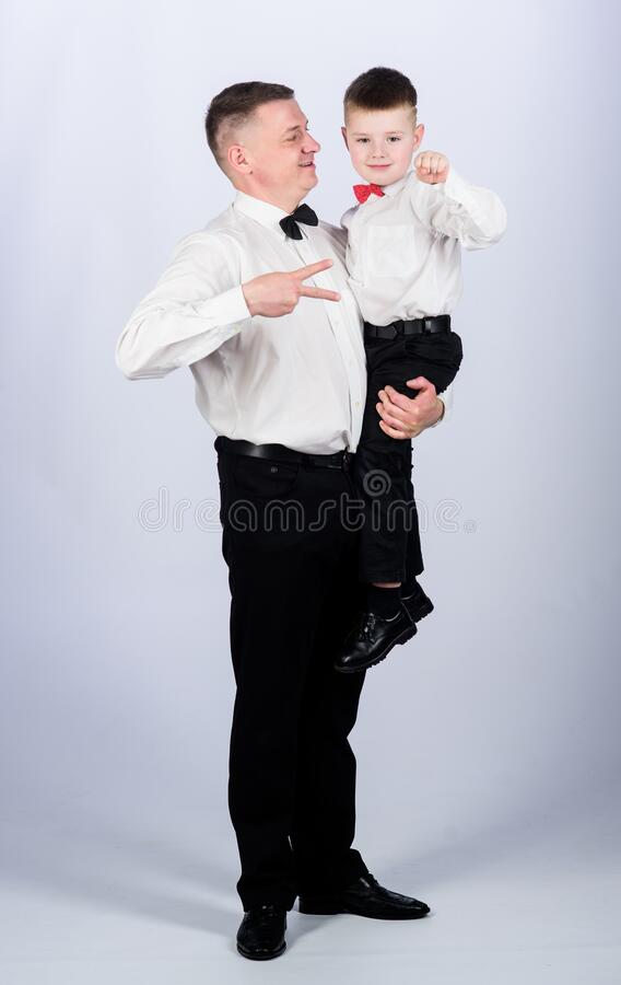 Grow up gentleman. Gentleman upbringing. Little son following fathers example of noble man. Family holiday. Relations of. Dad and son. Gentleman upbringing royalty free stock photography
