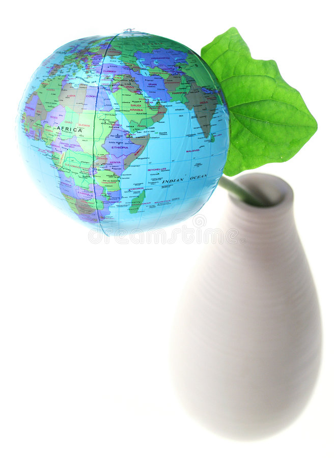 Grow the world. Flower earth growing out of vase royalty free stock image