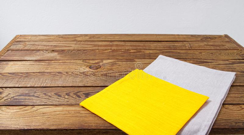 Grow and yellow paper napkin on empty table, food background, mock up royalty free stock photos