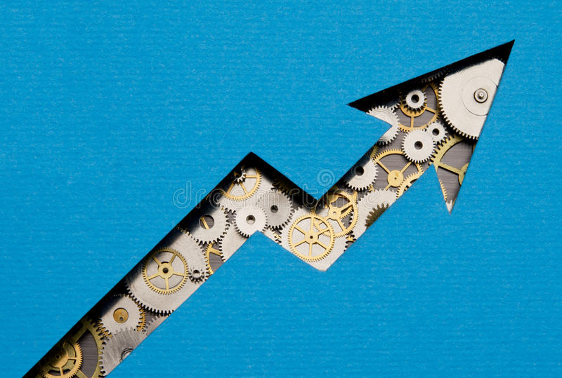 Growing business. Gears and cogs forming the shape of a growing chart stock photography