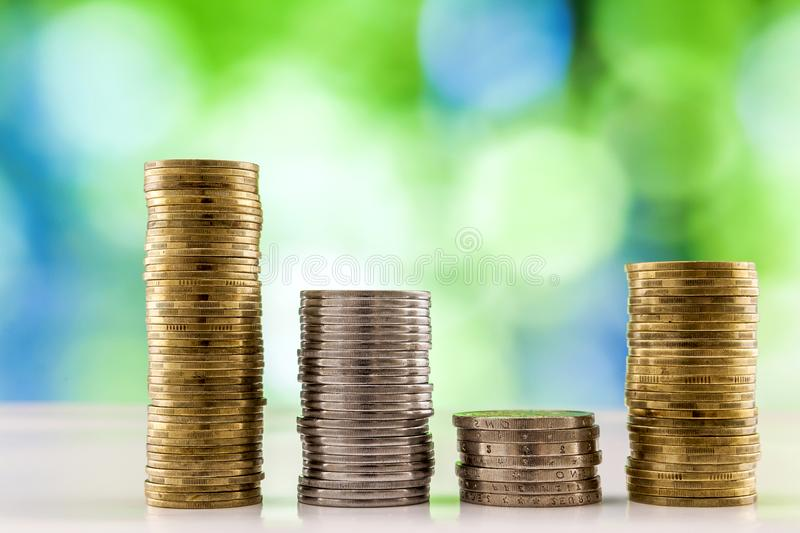 Growing coins stacks with green and blue sparkling bokeh background. Financial growth, saving money, business finance wealth and. Success concept stock image
