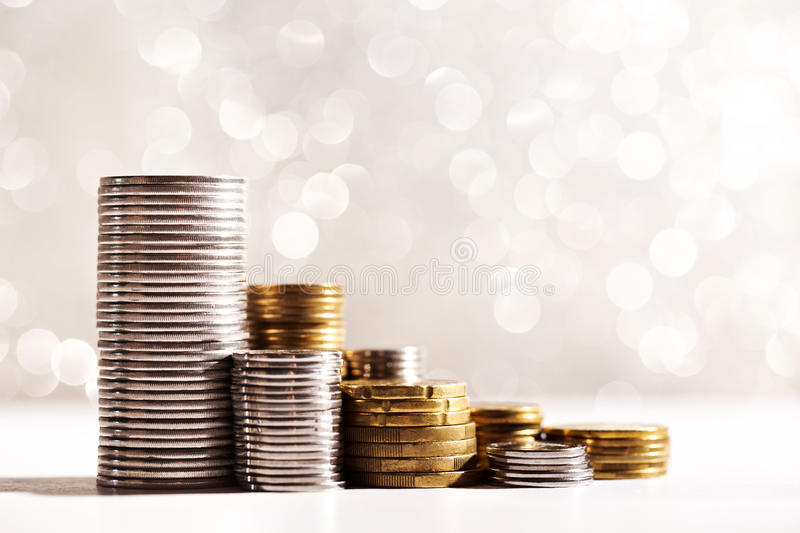 Growing coins stacks. Coins stacks with silver sparkling bokeh background. Financial growth concept stock images