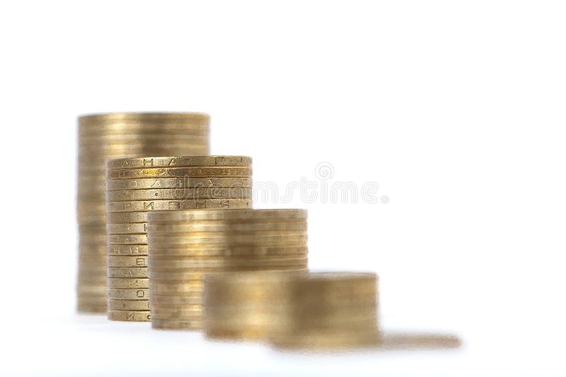 Growing coins stacks on white background. Financial growth, saving money, business finance wealth and success concept stock photo