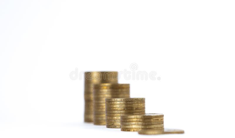 Growing coins stacks on white background. Financial growth, saving money, business finance wealth and success concept royalty free stock photo