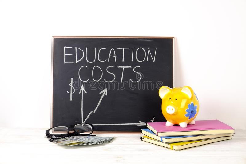 Investing time and money into education concept. Different school supplies, banknotes. Top view, close up. royalty free stock photography