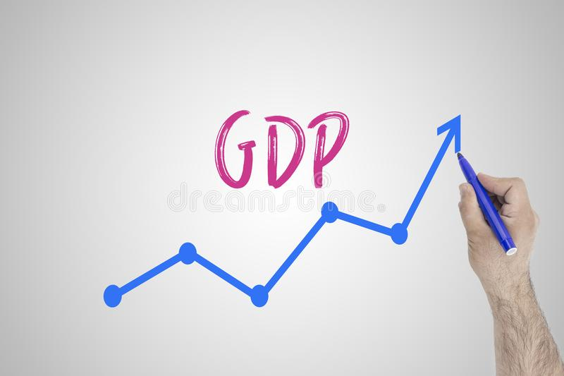 Growing GDP concept on white board. Businessman draw accelerating line of improving GDP against whiteboard. stock image