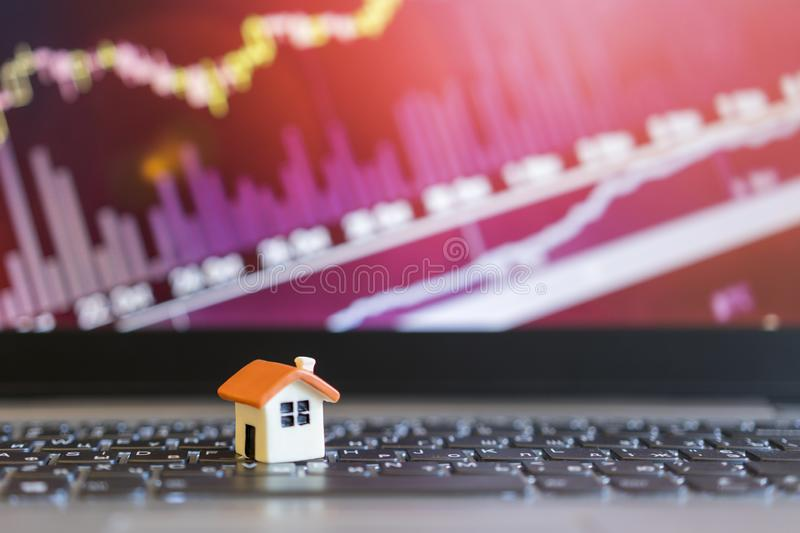Growing home sale grap. model of the house on the background of growth graph. The concept of rising property prices stock images