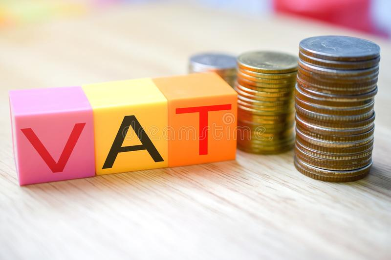 Growing taxes - colour blocks with VAT and money stacks royalty free stock photography