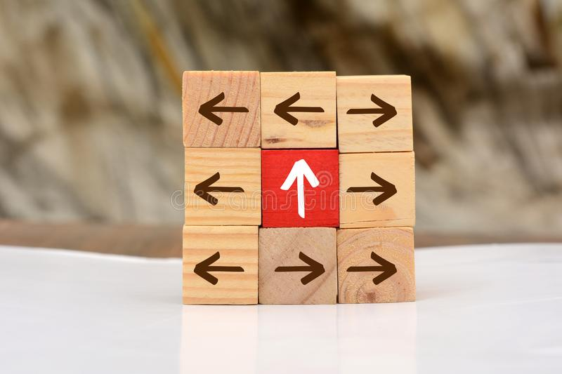 Growing Up concept with wood blocks arrow going upward.  stock images