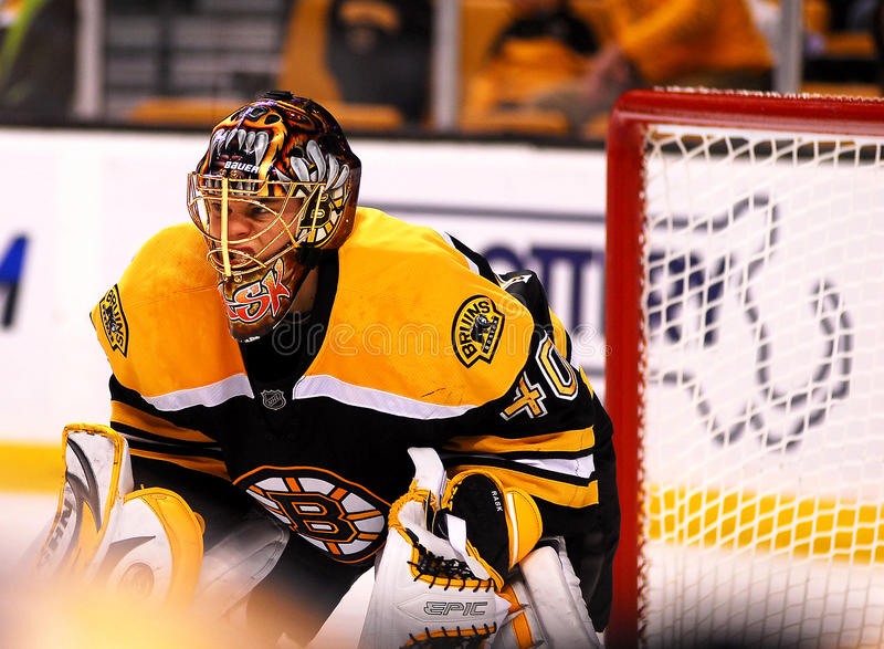 Growling Bear. Boston Bruins goalie Tuukka Rask appears to be growling as he prepares for a face-off in his end stock photo