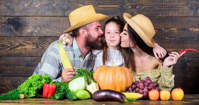 Grown with love. Family rustic style farmers at market with vegetables fruits and greenery. Parents and daughter harvest. Festival. Family farm concept. Family royalty free stock images