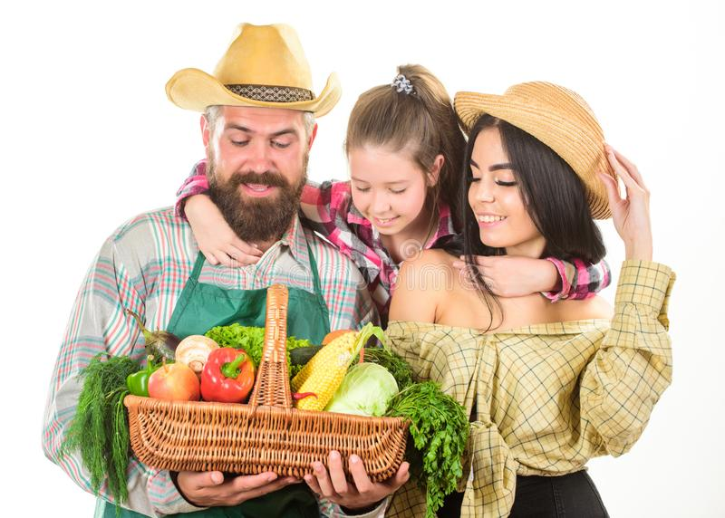 Grown with love. Parents and daughter celebrate harvest. Harvest festival concept. Family farmers gardeners vegetables. Harvest isolated white background royalty free stock photos