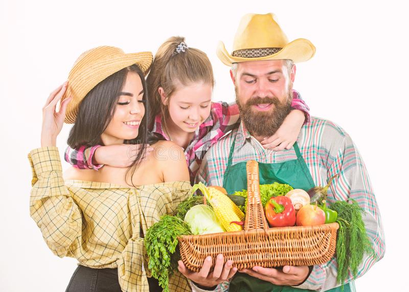 Grown with love. Parents and daughter celebrate harvest. Harvest festival concept. Family farmers gardeners vegetables. Harvest isolated white background stock photo