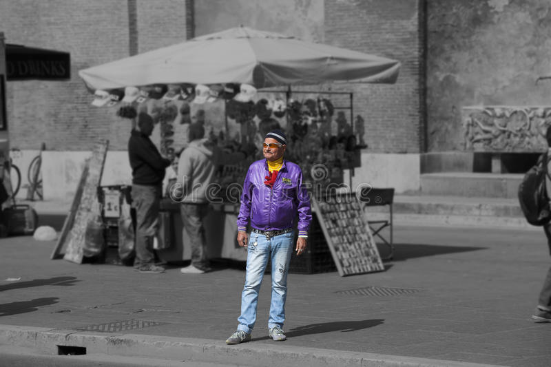 Grown man dressed in an unusual way in Rome, Italy. A grown man dressed in an unusual way in Rome, Italy. He is on the sidewalk and watch something. He dresses stock photography