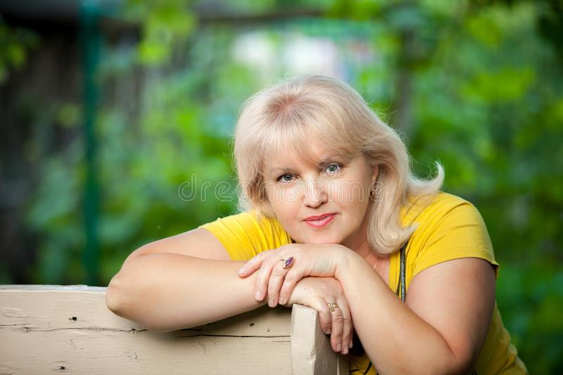 A grown woman on a green background stock photo