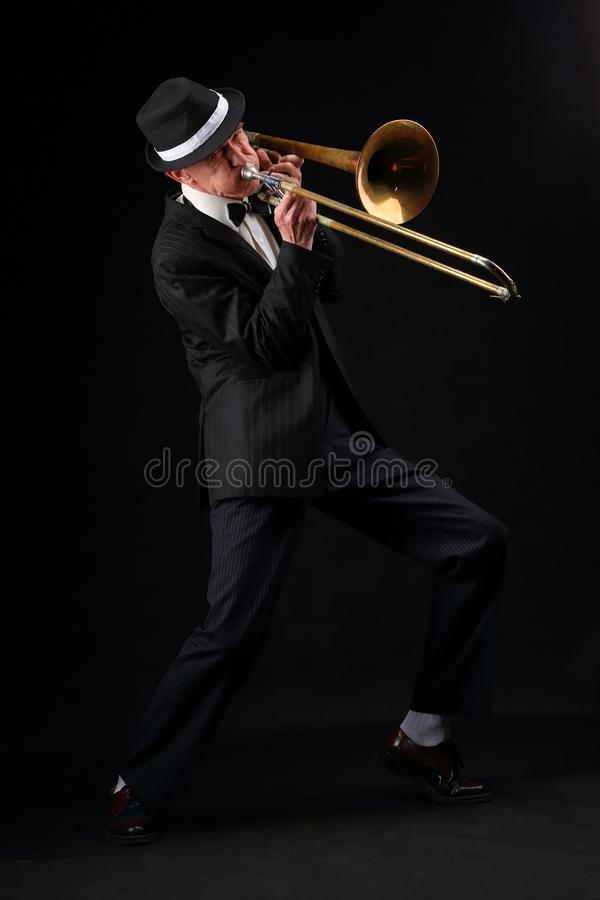 Growth portrait of an elderly musician with a trombone. Growth portrait of an elderly jazz musician while playing the trombone stock images