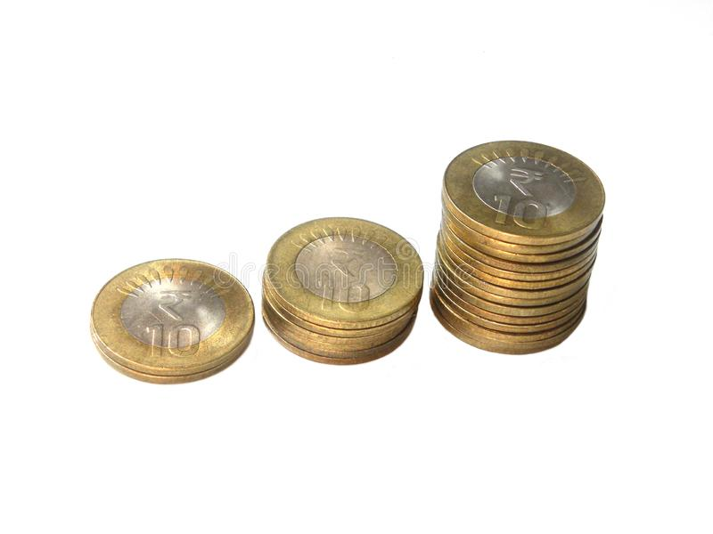 Growth of 10 rupees India coins. Growth of ten rupees India coins on white background royalty free stock photos