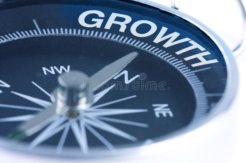 Growth word on compass stock photo
