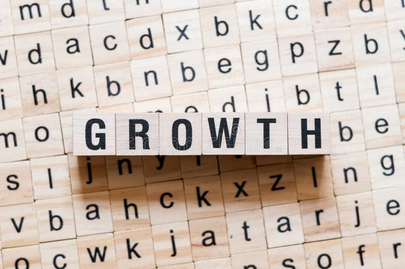 Growth word concept. On cubes stock image