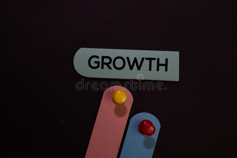 Growth write on a sticky note isolated on office desk stock photo
